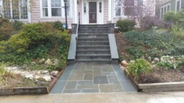 PA Flagstone steps, stoop and landing with railing and garden to the side