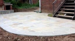 Pennsylvania flagstone patio in backyard with steps
