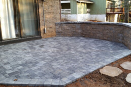 Paver patio and wall with stepping stones