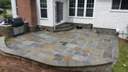 picture of Pennsylvania flagstone patio in backyard with a grill