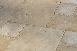close up of travertine stone pool deck