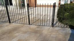 aluminum gate on travertine deck